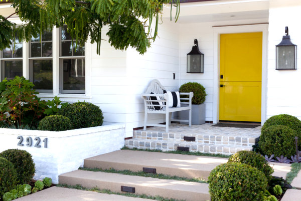 Vivid yellow front door 9 Easy Weekend Home Improvement Projects