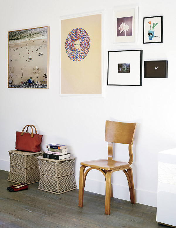 Wall of artwork in an eclectic hallway