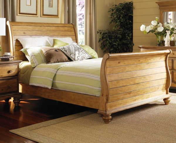 Warm wooden tones make the bedroom far more inviting