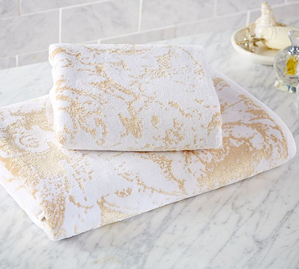 White and gold bath towels