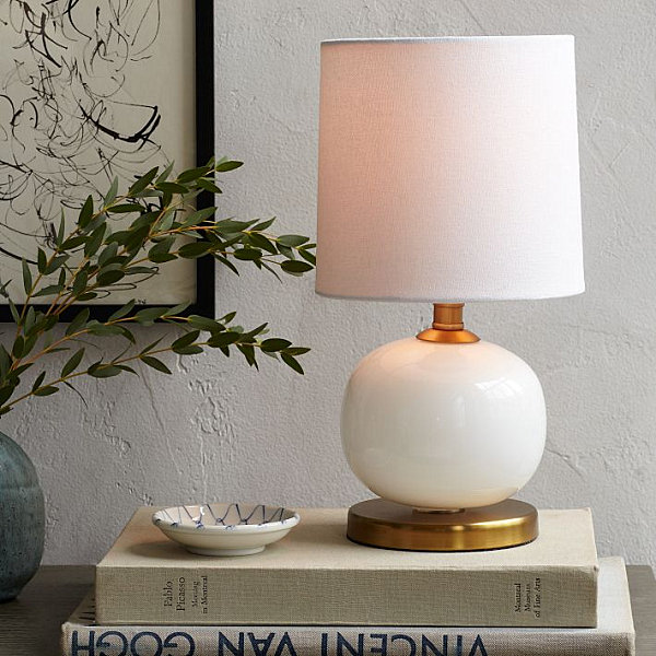 White table lamp with a bronze finish
