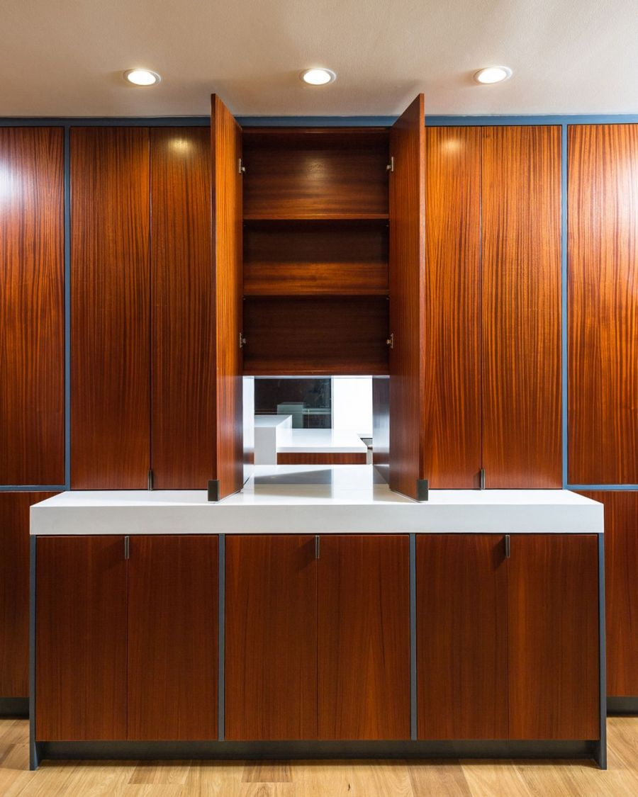 Wooden cabinets open up to reveal a window