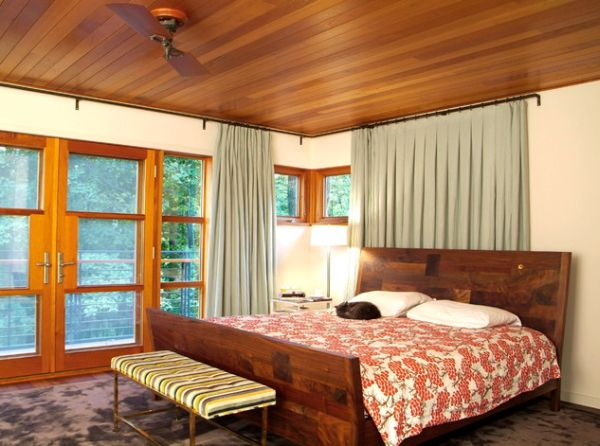 Wooden ceiling steals the show in this bedroom!