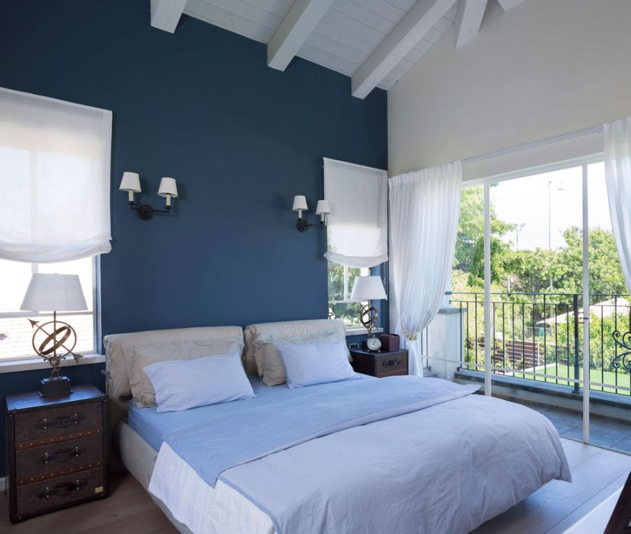 master bedroom of Tel Aviv home in white and blue
