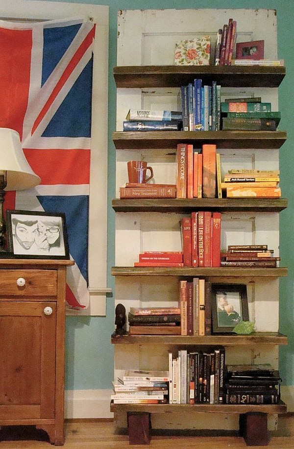 Reclaimed hardwood door turned into a rustic bookshelf