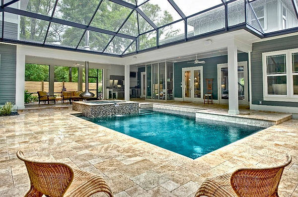 An orb fireplace and hot tub flank the cool pool