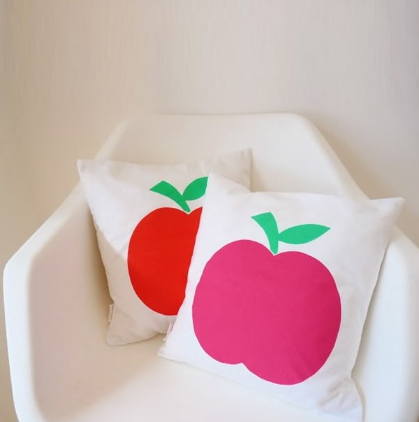 Apple cushions in a modern chair