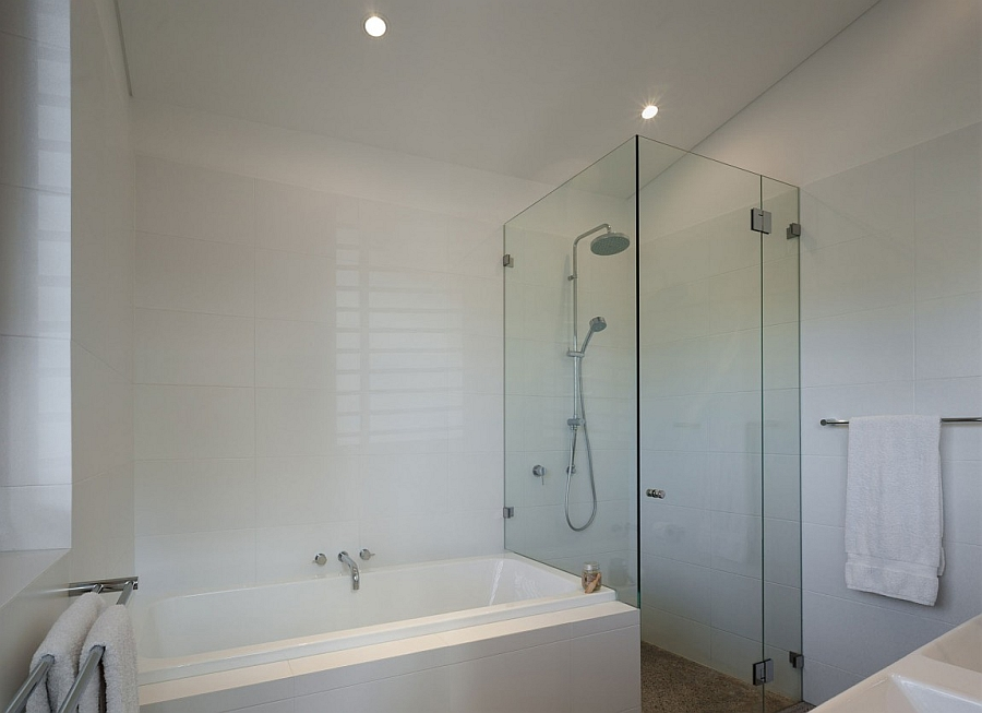Bathroom with glass shower and bathtub combo