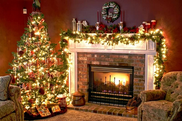 Beautifully illuminated Christmas tree next to the fireplace