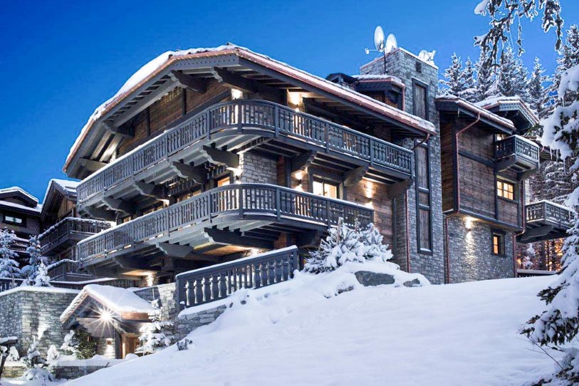 Beautifully lit Chalet Edelweiss in the evening