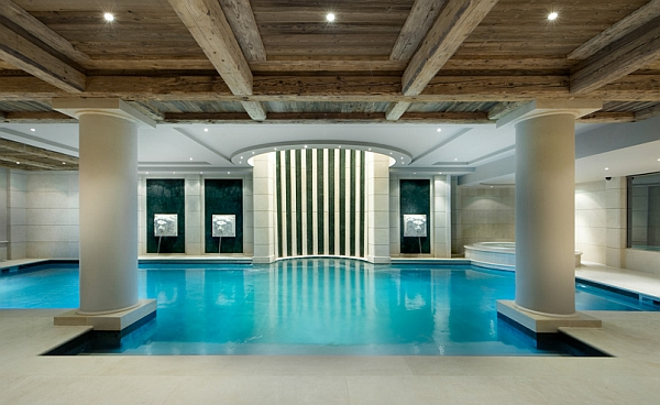Beautifully lit indoor pool in luxurious French Chalet