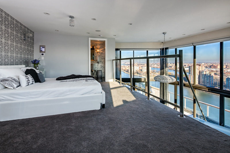 Bedroom with view of new york city skyline