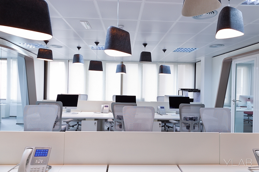 Black pendant lights in contemporary office