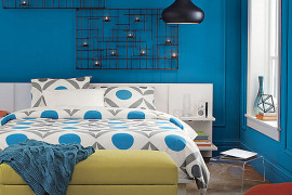 Blue room with orange pillow