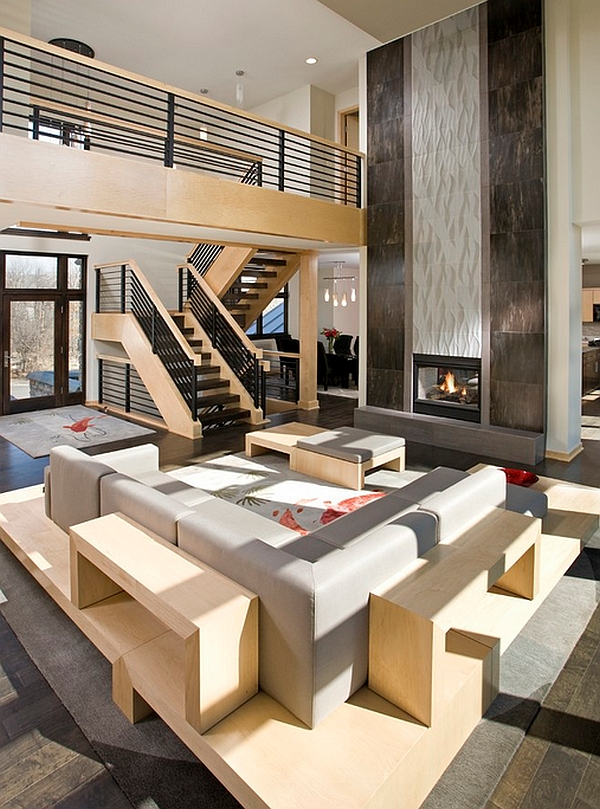 Bold fireplace steel railings define lavish open floor living area