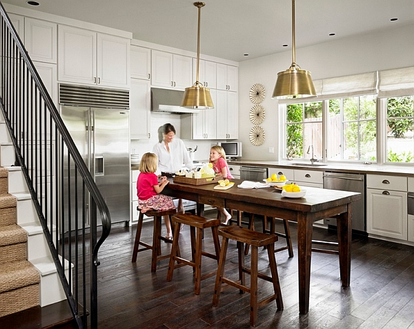 Brass pendants are a cool way to add a bit of metallic tinge to the kitchen
