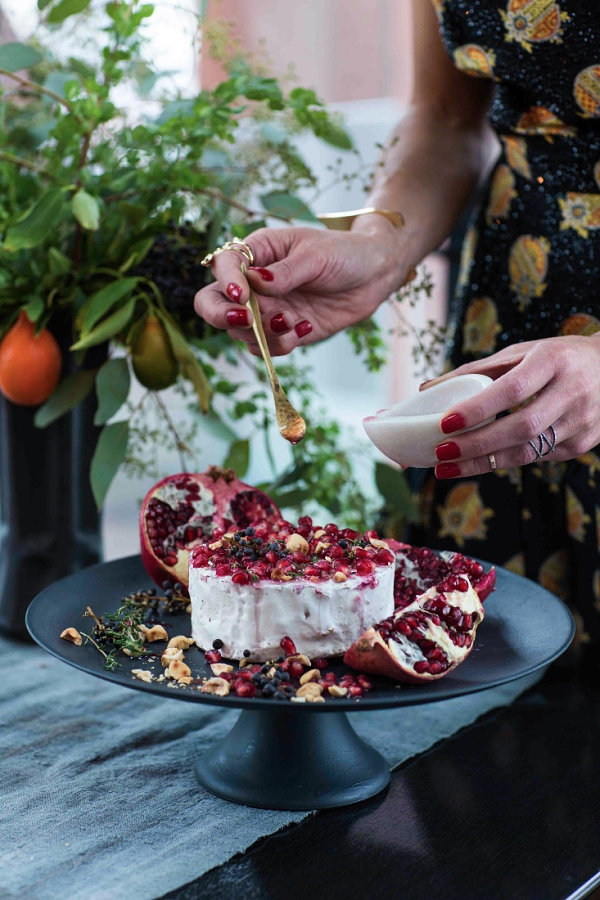 Brie topped with pomegranate seeds