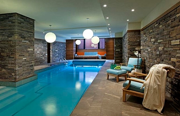 Brilliant pendant lights illuminate the indoor pool