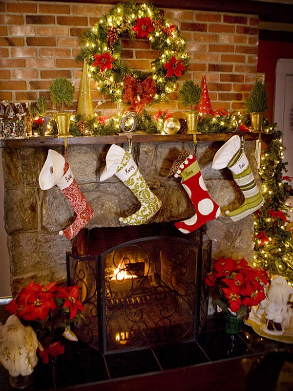 Christmas stockings pinned to the fireplace mantel