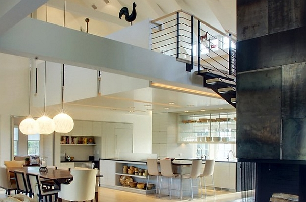 Classy contemporary kitchen and dining area sit neatly under the mezzanine level