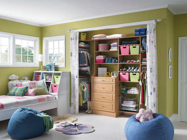 Colorful storage in a girl's room closet