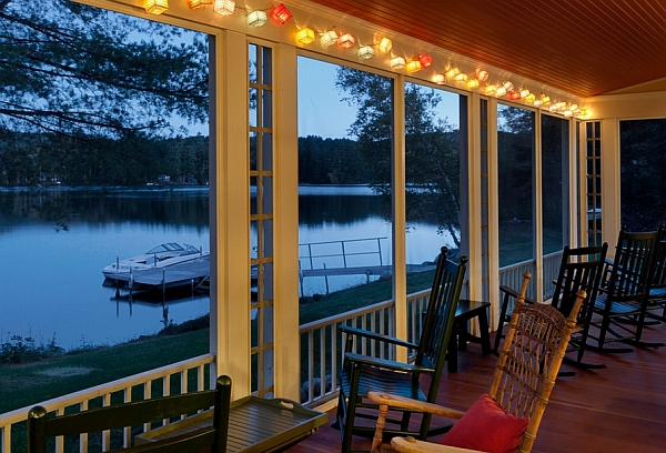 Colorful string lights inside the screened porch