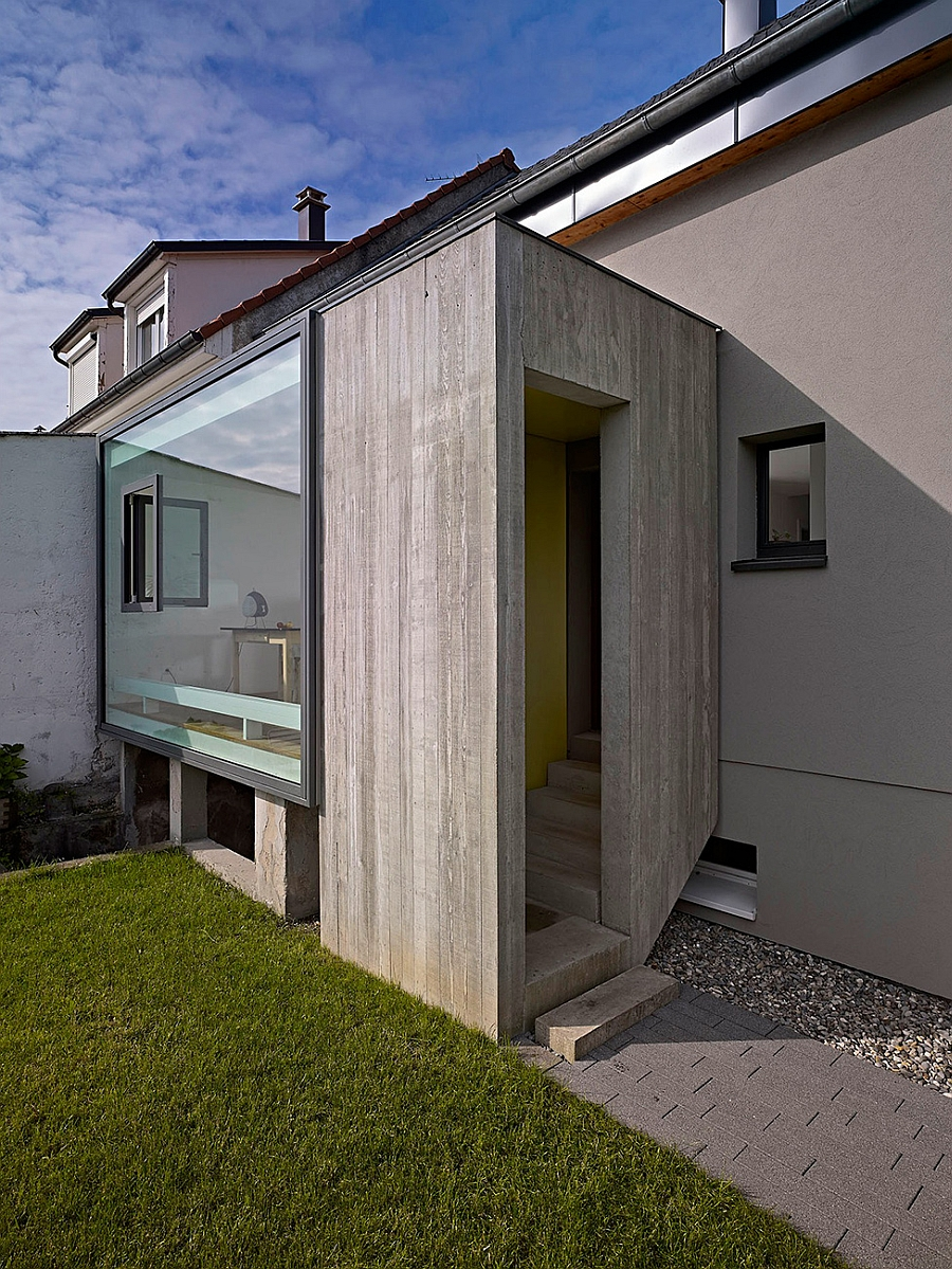 Concrete and glass exterior of the renovated French home