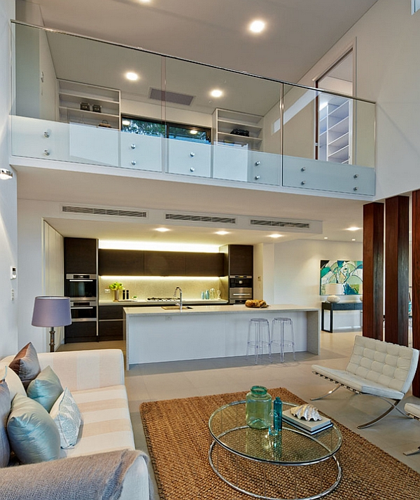 Contemporary living room in white with glass fence for mezzanine floor