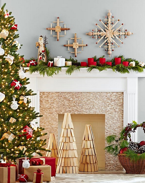 diy wooden christmas tree replicas and handmade snowflakes adorn the fireplace