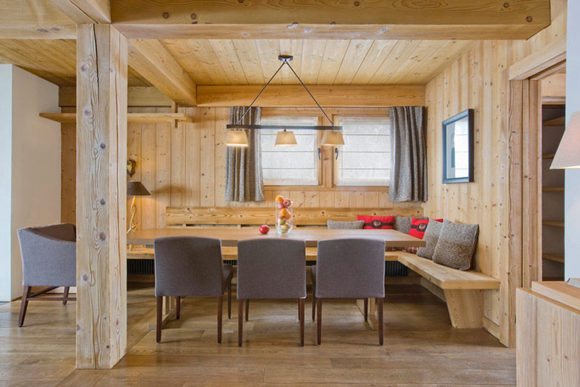 Dining area with wooden walls