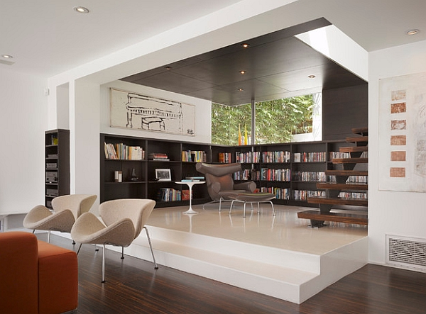View In Gallery Elevated Floor Creates Organized Space Without Walls