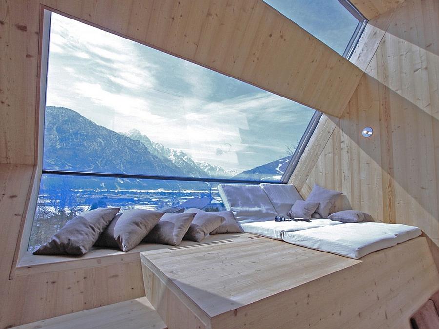 Enjoy majestic mountain views outside through the window