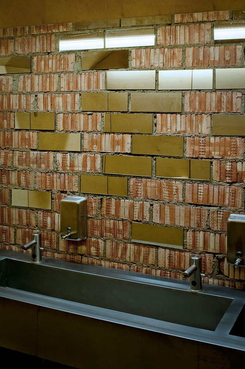 Exposed barebrick surface above the sink