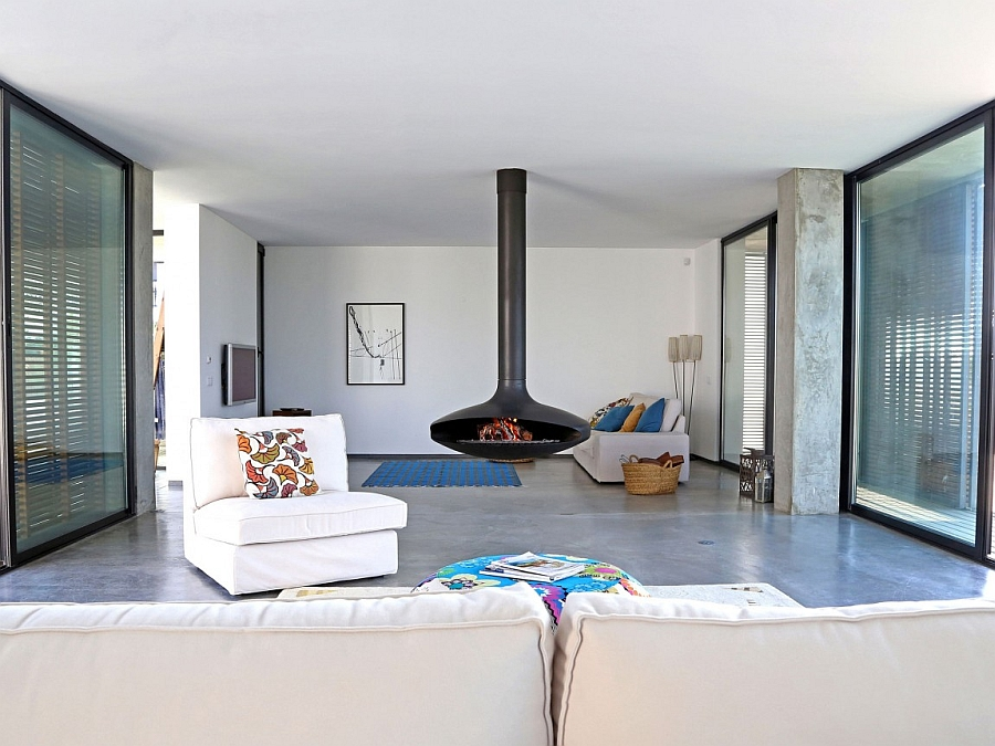 Fire orb and modern decor inside the villa Lavish Portuguese Villa Charms With Crafty Use of Concrete