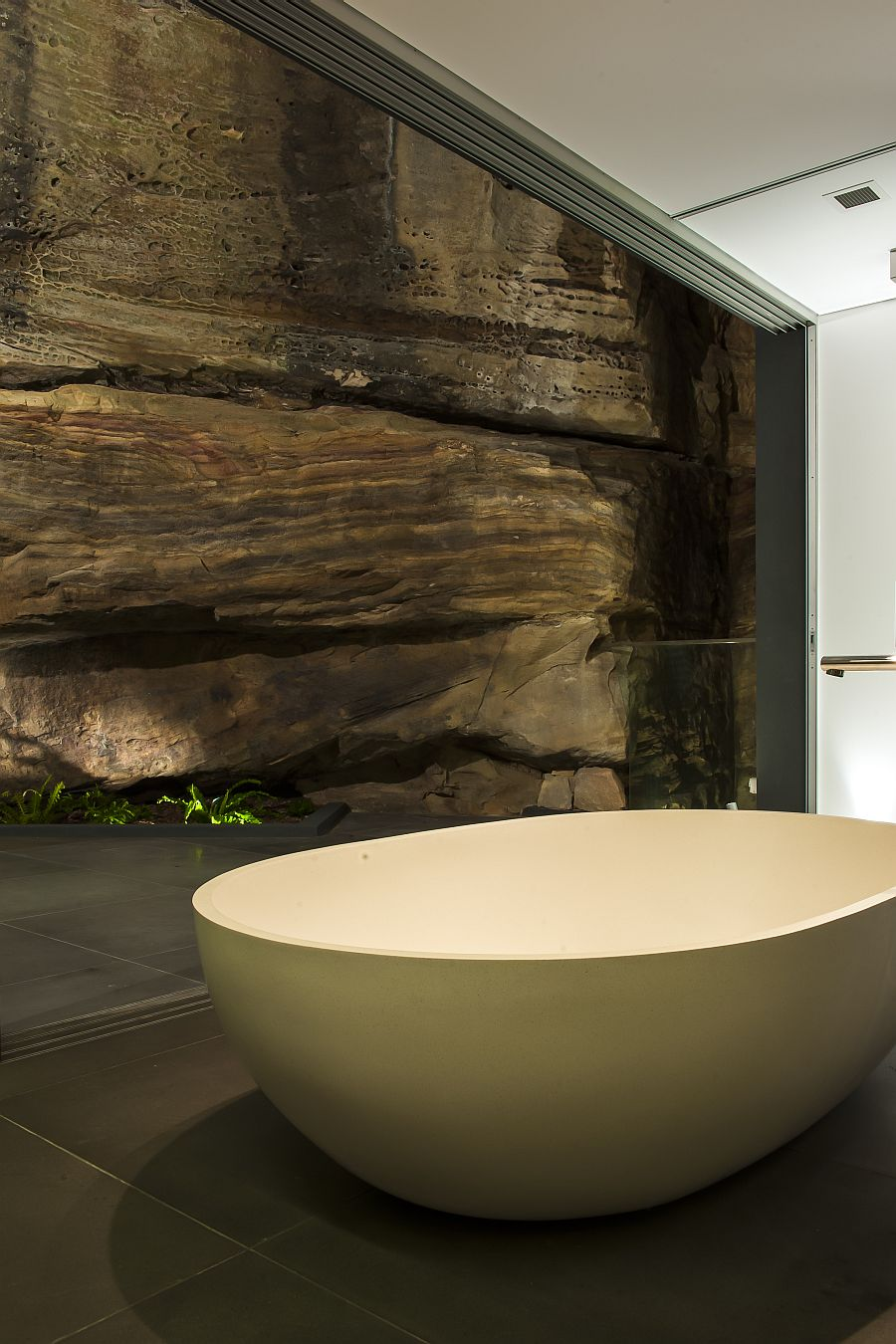 Freestanding bathtub with the natural cliff wall behind it