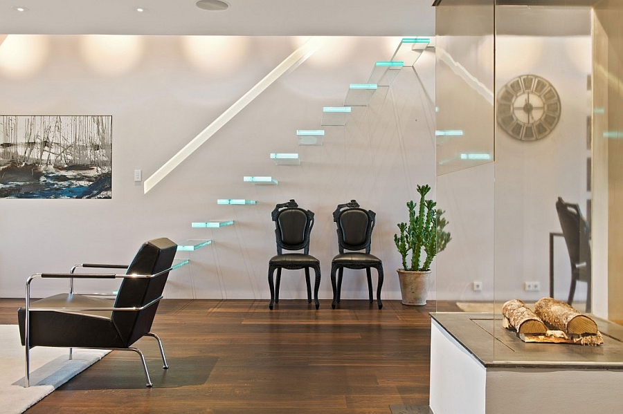 Gorgeous floating staircase leading to the top level Luxurious Loft Apartment In Stockholm Showcases Stunning Views Of The Citys Skyline