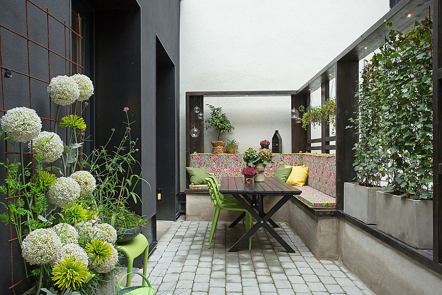 Gorgeous patio with stylish seating and plenty of greenery