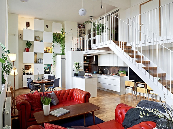Green walls and colorful decor accentuate the look of this Swedish loft