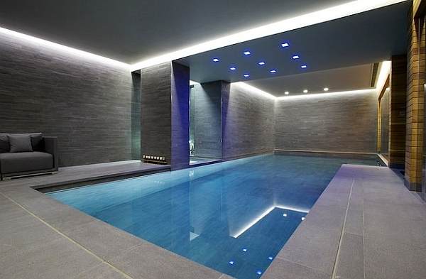 Grey walls and recessed lighting give this indoor pool a minimalist appeal