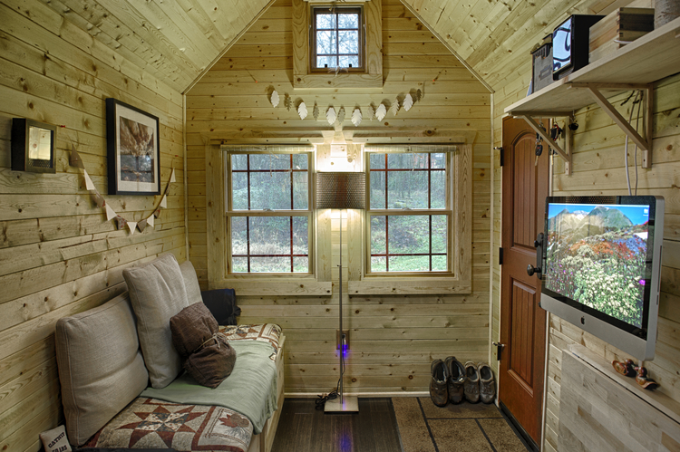 Hand built tiny tack house with cozy interiors