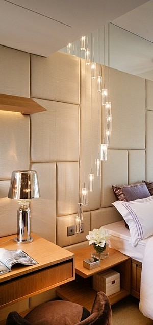 Hanging chandelier pendants double as bedside lighting