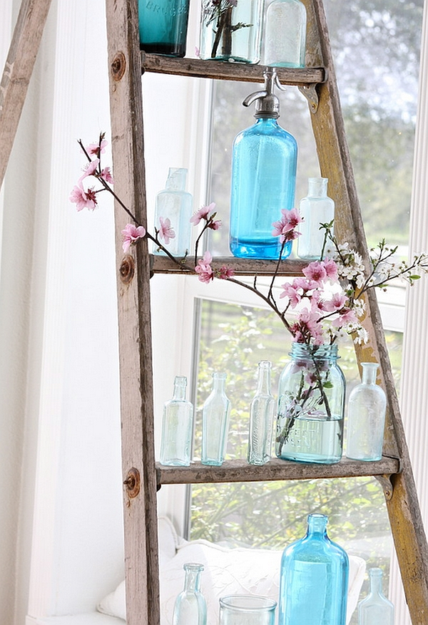 Hint of nature, vintage bottles and a rustic ladder create a unique DIY display