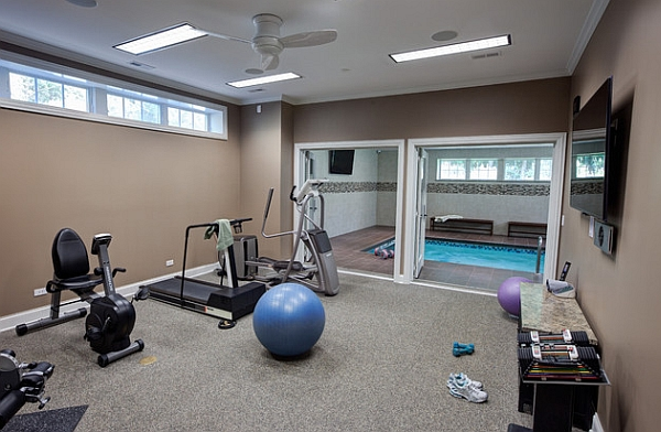 Home gym next to the elegant indoor pool
