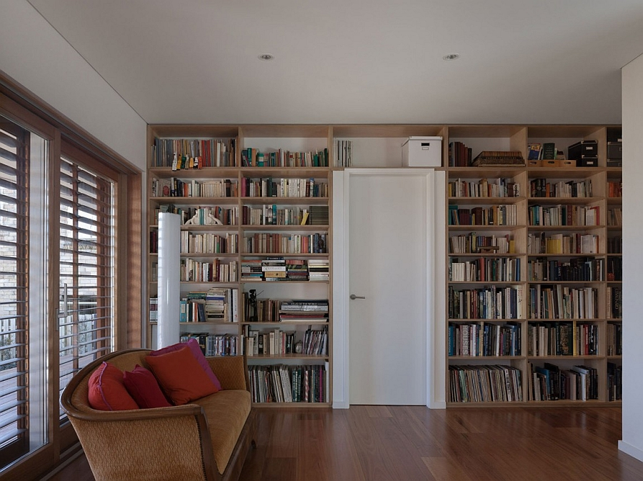 Home library design with a wall of books