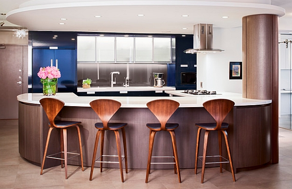 Iconic Cherner counter stools in walnut finish