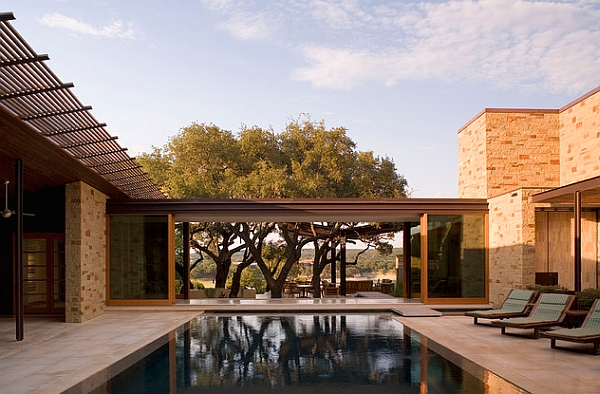 Indoor courtyard with an elegant reflecting pool and seating area
