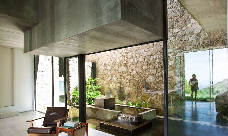 Indoor water feature at the rustic residence