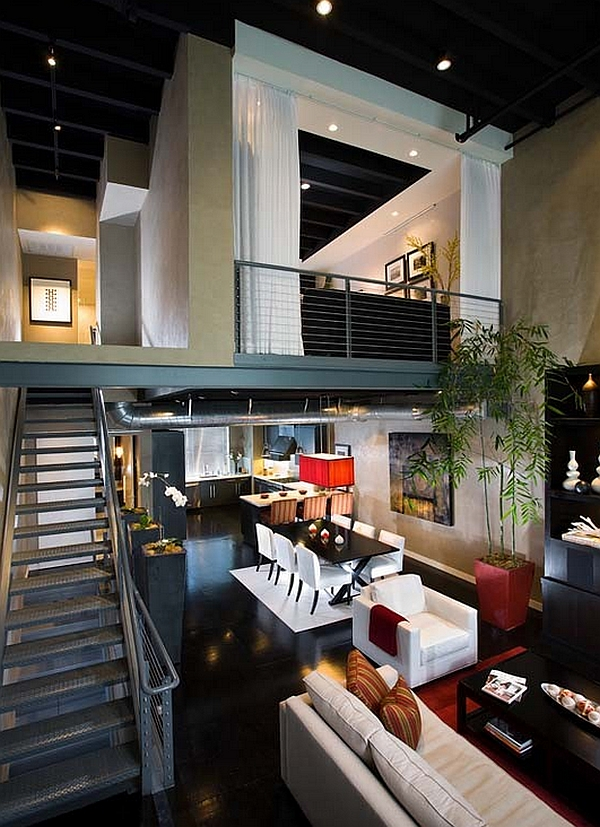 Industrial loft with a mezzanine level that features a guest bedroom