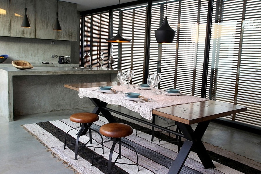Industrial styled kitchen with cool pendant lights