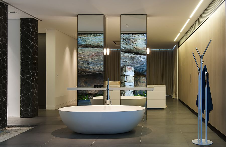 Large freestanding bath with mirrored backdrop